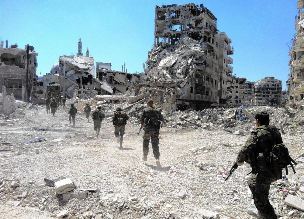 la-afp-getty-syria-conflict-anniversary-files3-j-20140327